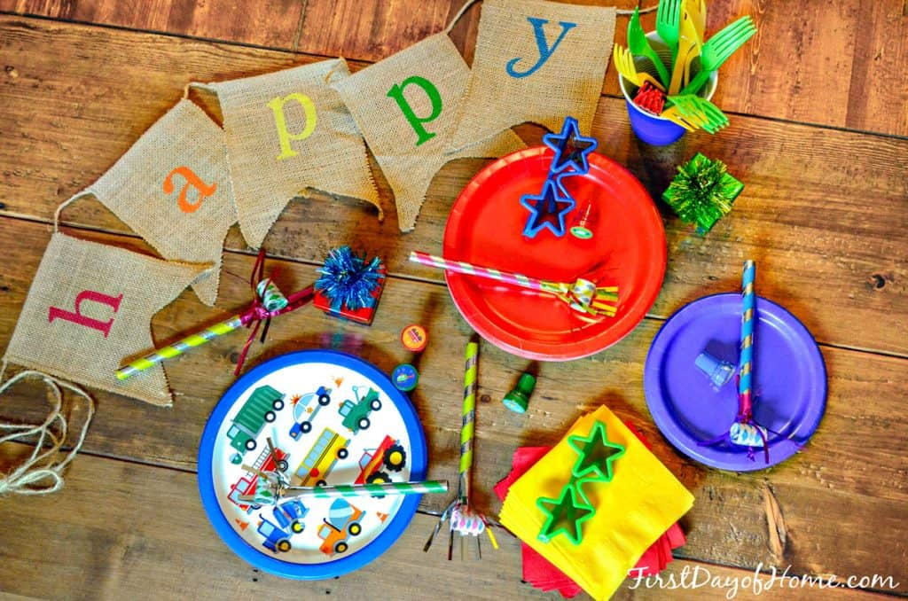 Transportation themed birthday party paper supplies, including transportation plates, napkins and favors