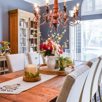 Spring dining room decor with simple floral centerpiece and pillar candles