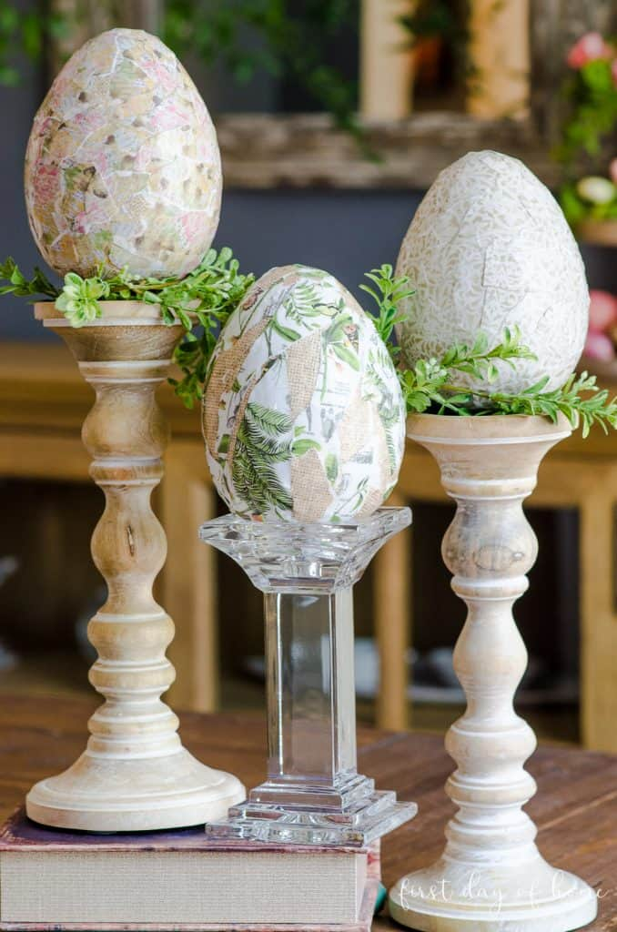 Three decoupage Easter eggs on candlesticks