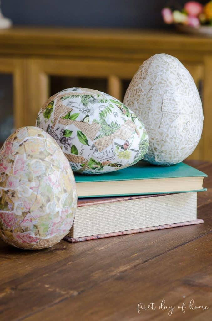 Decoupage Easter eggs sitting on old books