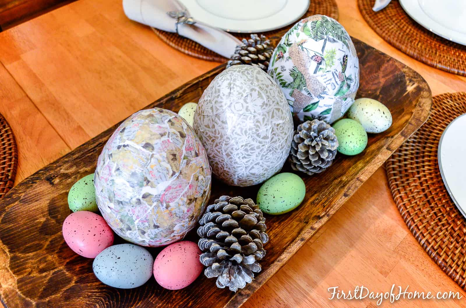 Decoupage Easter eggs sitting in dough bowl on table