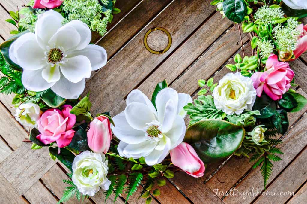 Pink and white florals on grapevine wreath for front door spring wreath