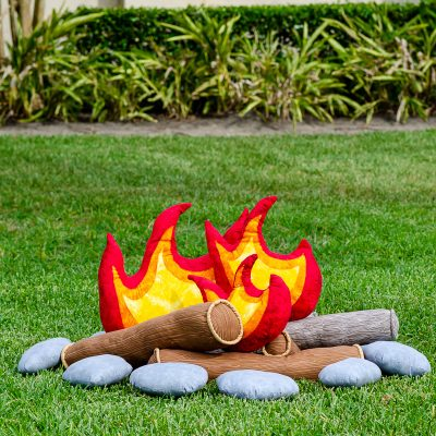 Kids pretend campfire set on grass outdoors