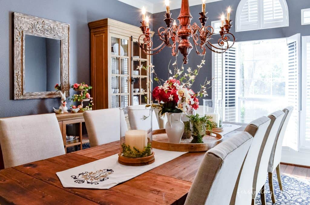 Formal dining room with blue walls and spring decorated tablescape