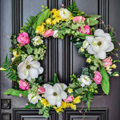 Easter spring floral wreath hanging on door of front porch