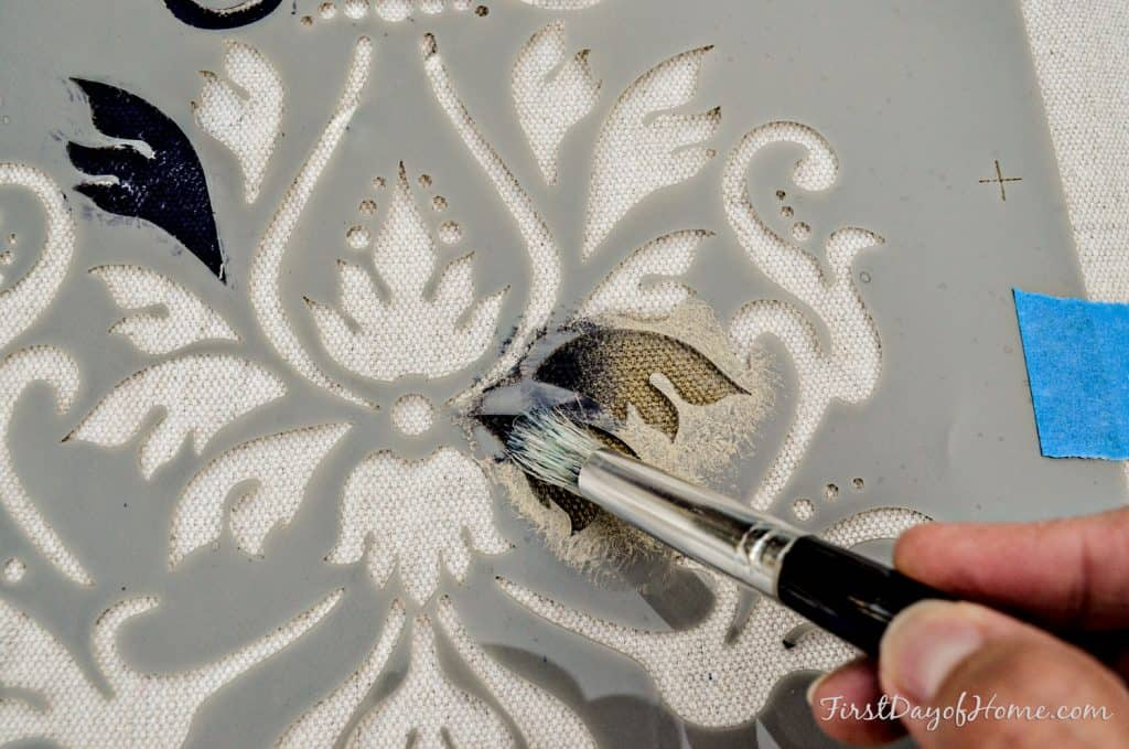 Adding depth to stencil with multiple layers of paint on a drop cloth table runner