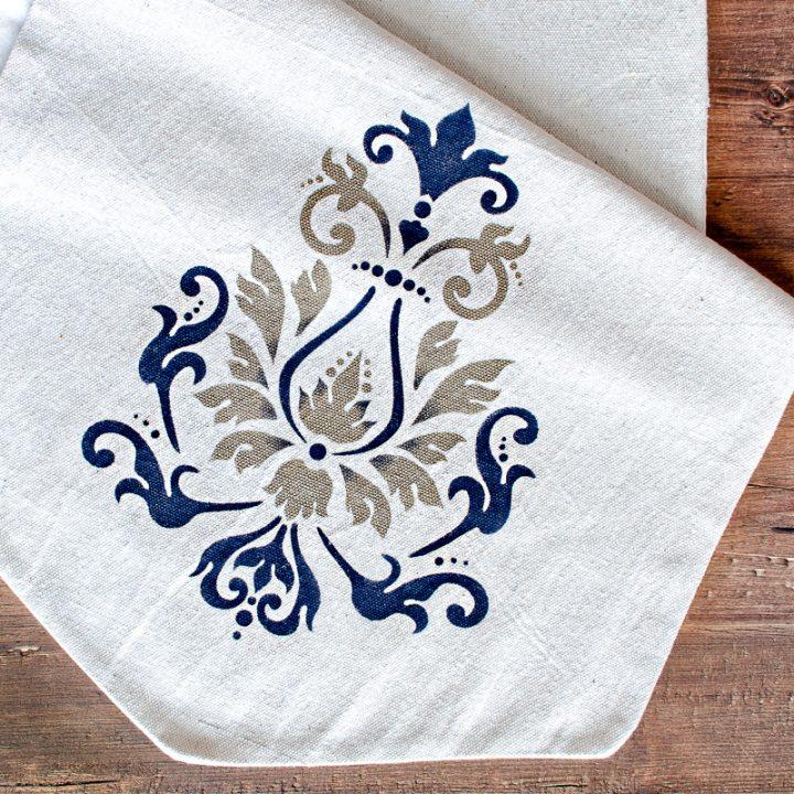 Stenciled farmhouse table runner with stenciled fleur de lis design