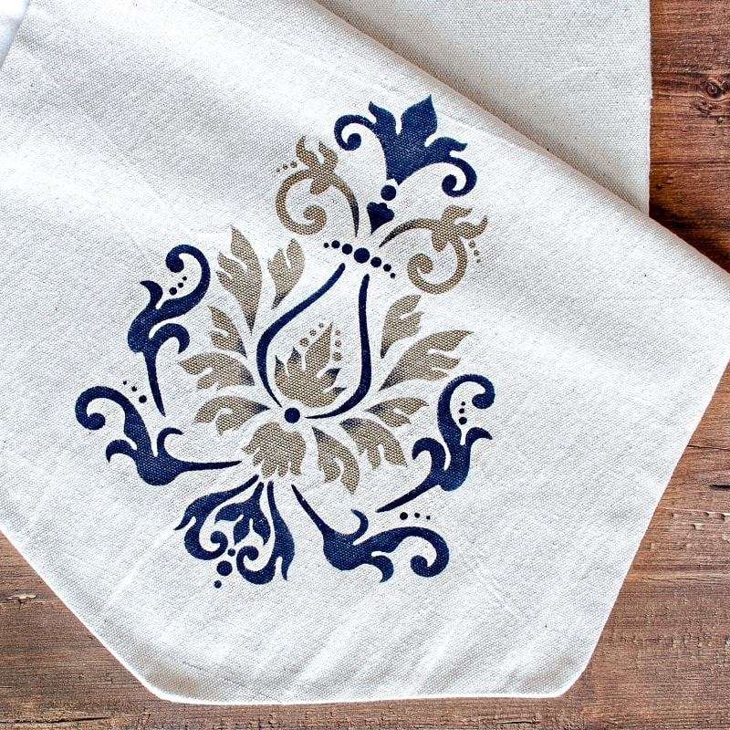 Stenciled farmhouse table runner with stenciled fleur de lis design