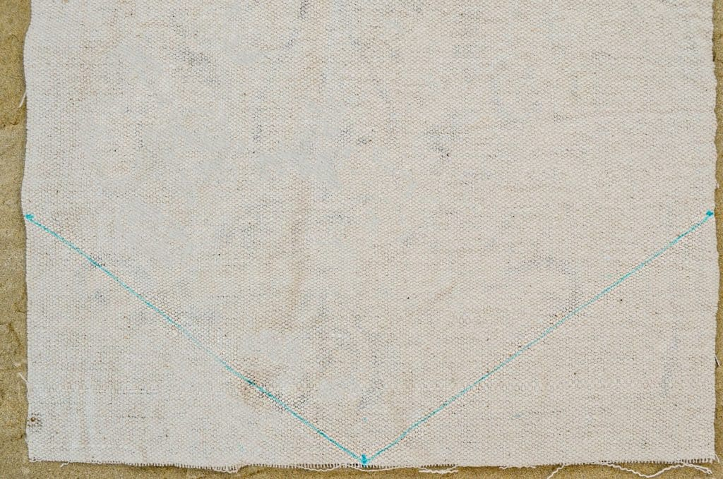 Drawing lines for peak at ends of a custom stenciled drop cloth table runner