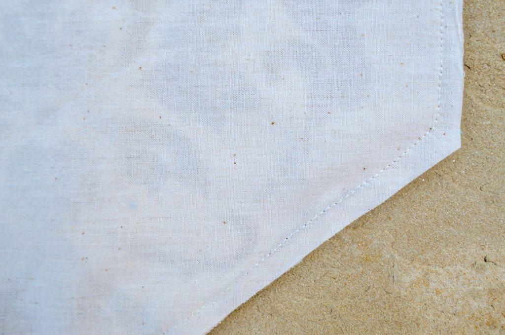 Sewn edge of custom DIY drop cloth table runner