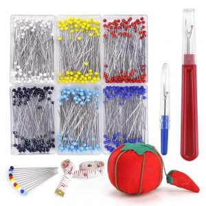 Sewing essentials, including needles, cushion and seam ripper