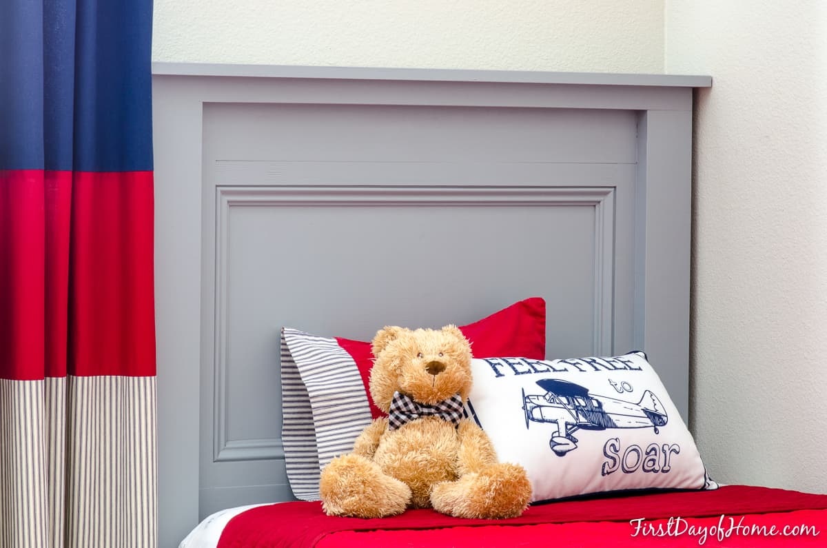 DIY farmhouse headboard in grey color with twin bed and red bedspread