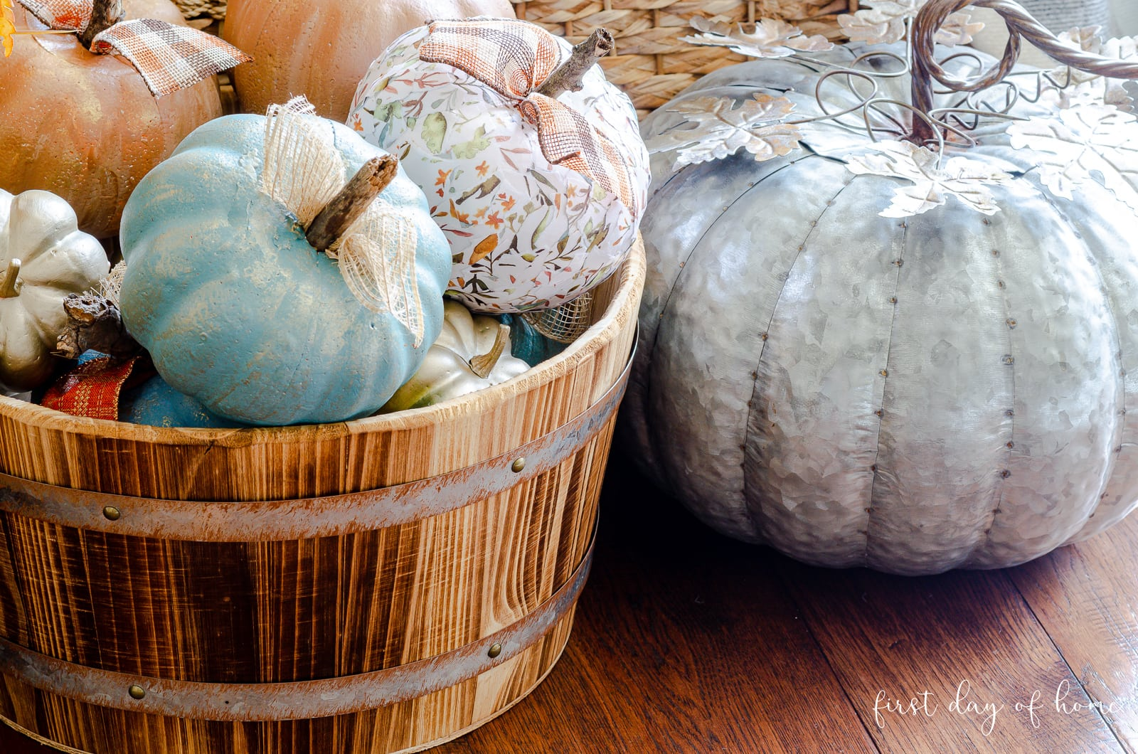 Painted pumpkin and decoupage pumpkin in barrel made from dollar store pumpkins