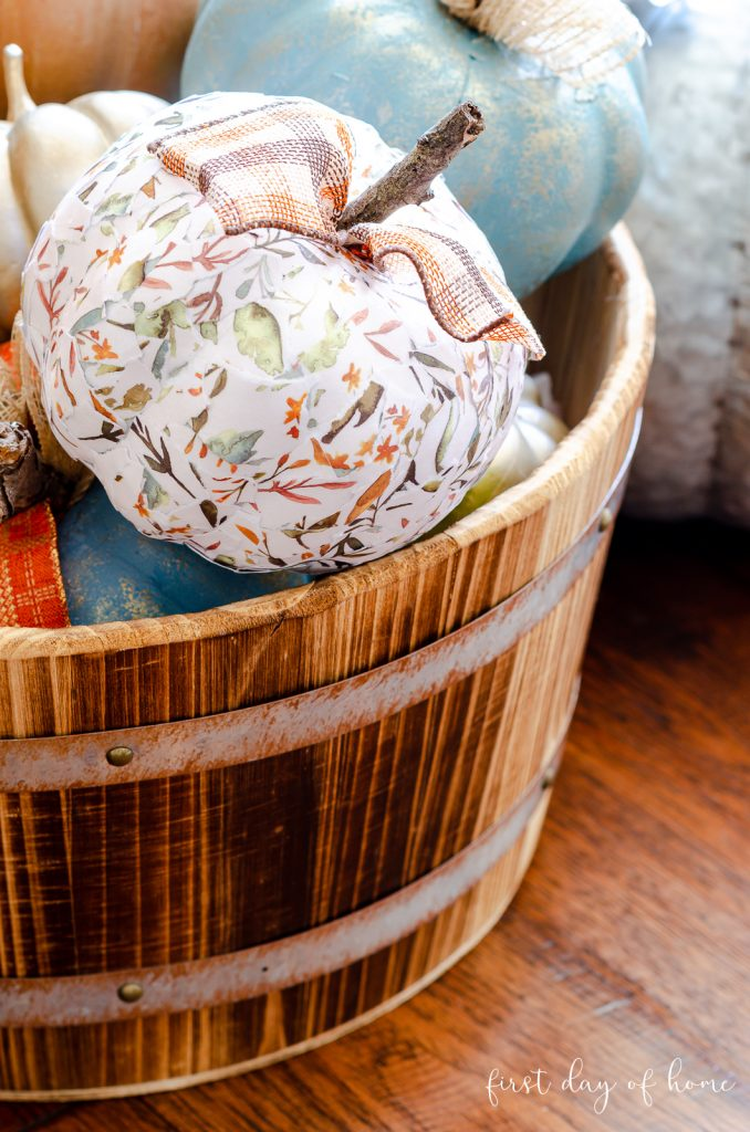 Decoupage pumpkin in farmhouse style barrel for DIY fall decor
