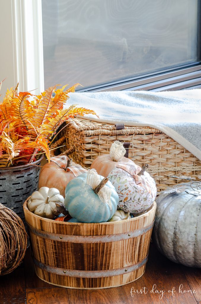 Decoupage pumpkins and painted pumpkins in farmhouse barrel using dollar store foam pumpkins