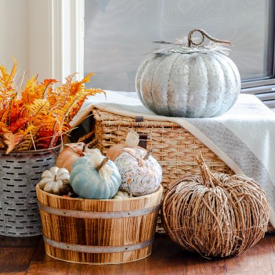 Painted pumpkins and decoupage pumpkins in barrel