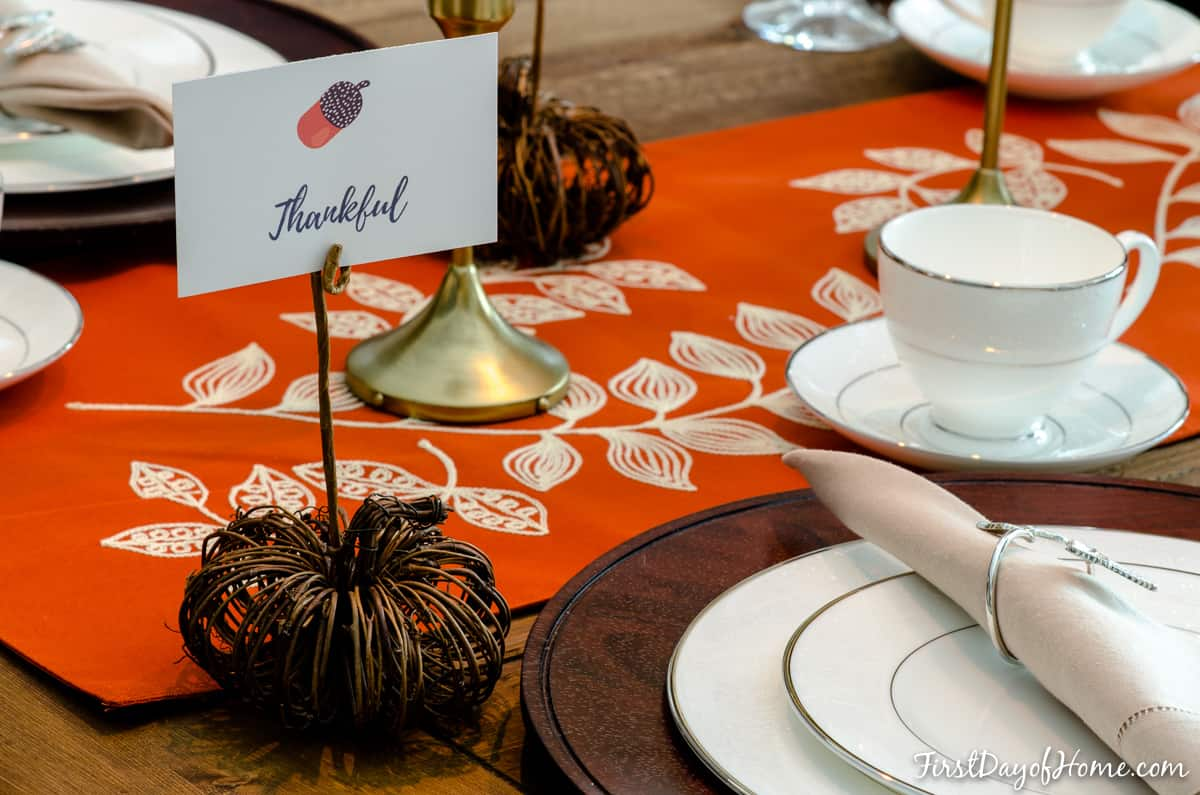 DIY pumpkin place card holder on Thanksgiving tablescape