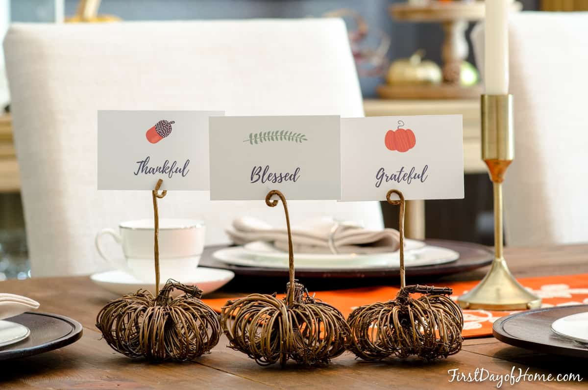 DIY pumpkin place card holders on table set for Thanksgiving meal