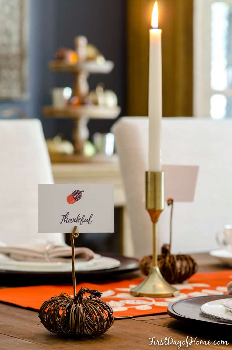Final DIY pumpkin place card holder on Thanksgiving table