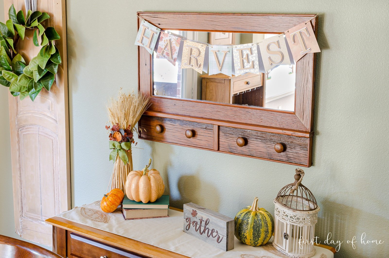 "Finished fall banner spelling ""Harvest"" hanging on mirror"