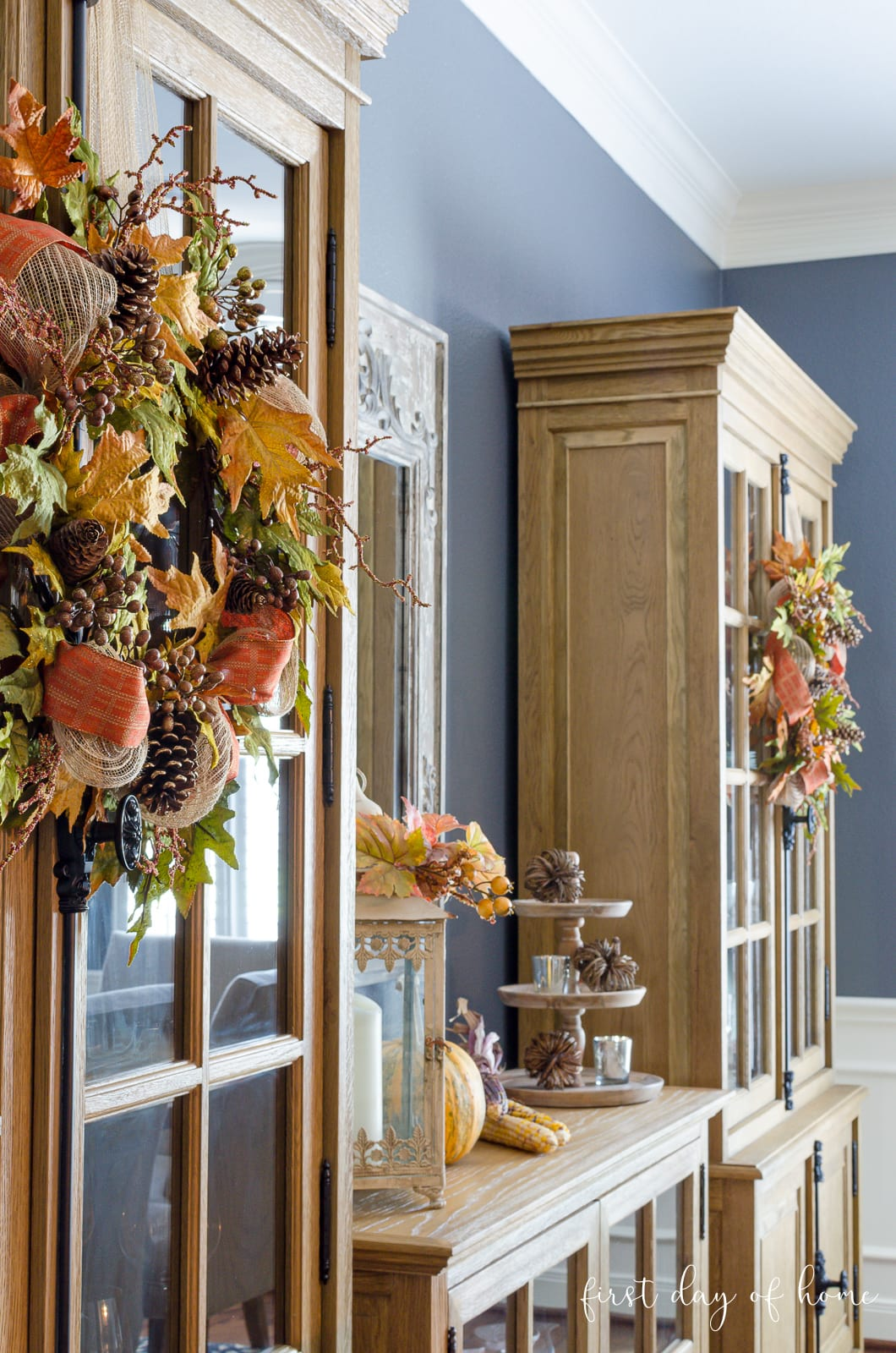 Fall wreaths on matching reclaimed wood cabinets and sideboard