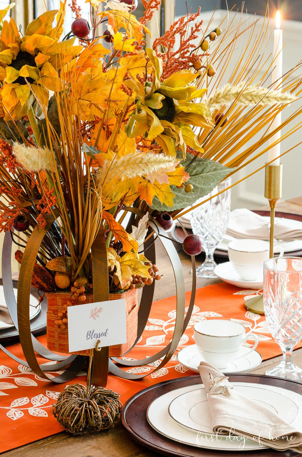 Fall formal dining room centerpiece with orange and yellow fall foliage and DIY pumpkin place card holders