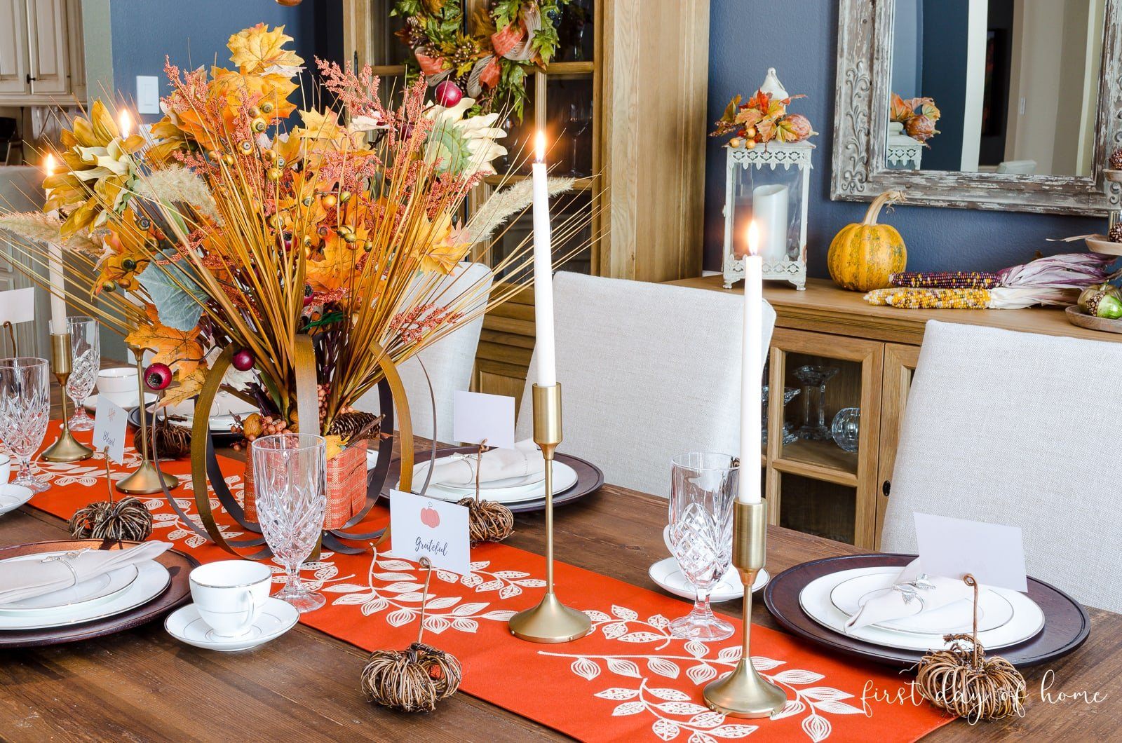 Fall dining room tablescape with autumn floral centerpiece, table runner and DIY pumpkin place card holders