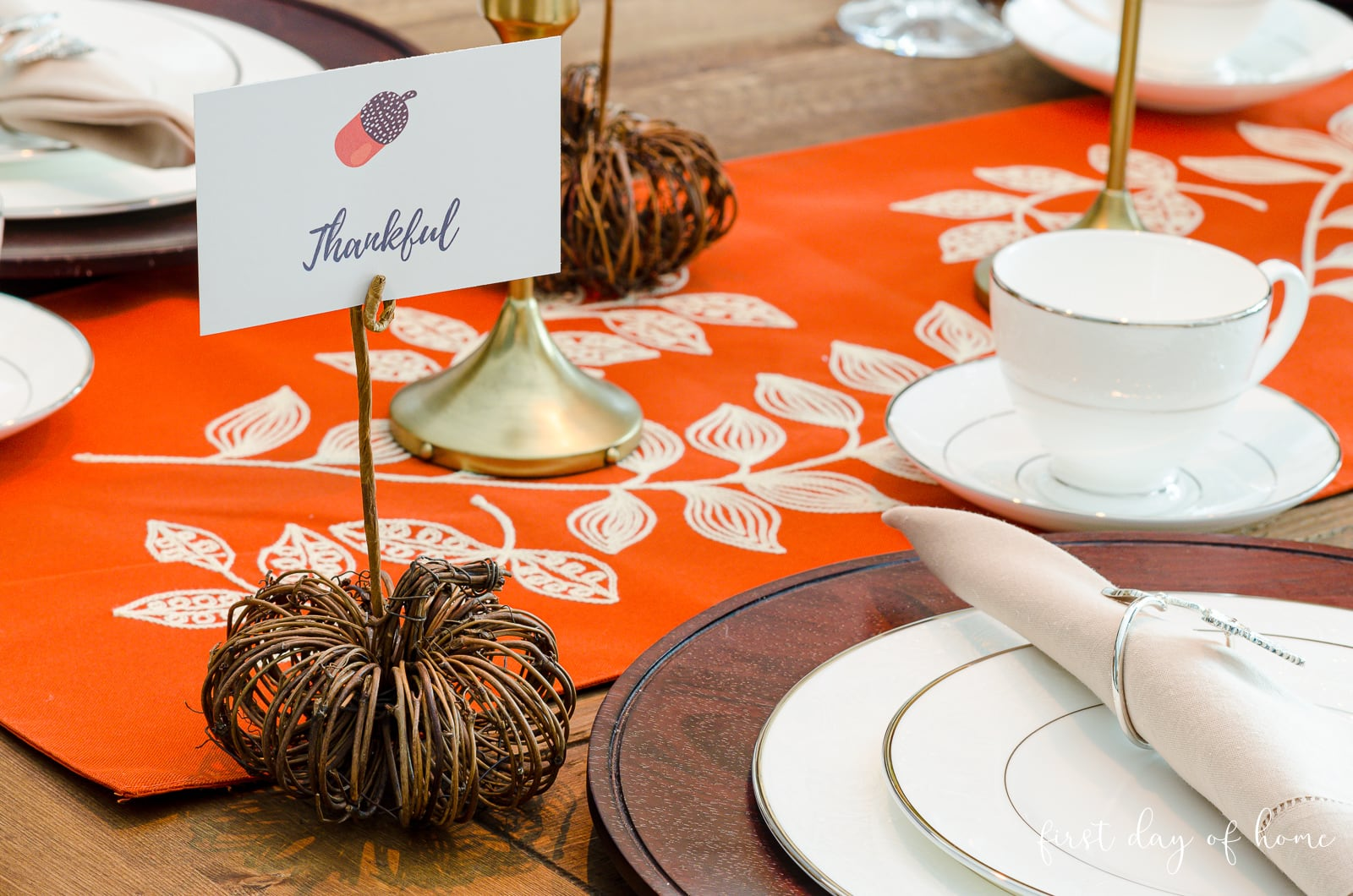 Close up of DIY pumpkin place card holder on fall dining room table
