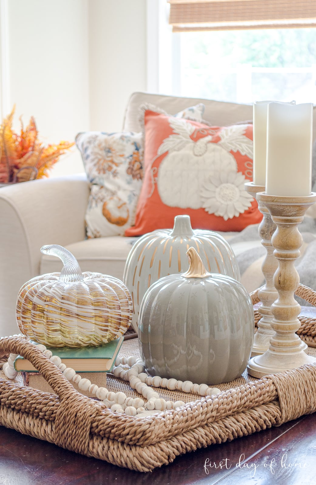 Fall living room centerpiece for coffee table with candle holders, pumpkins and beads