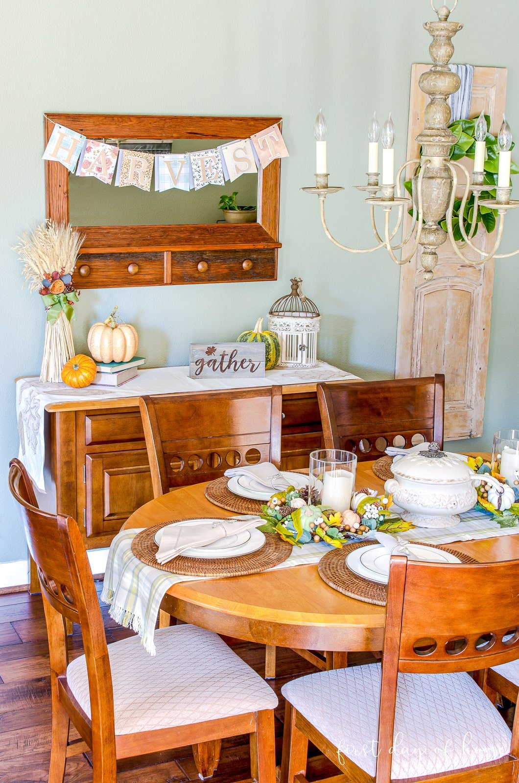 Breakfast room decorated for fall with green and peach color palette