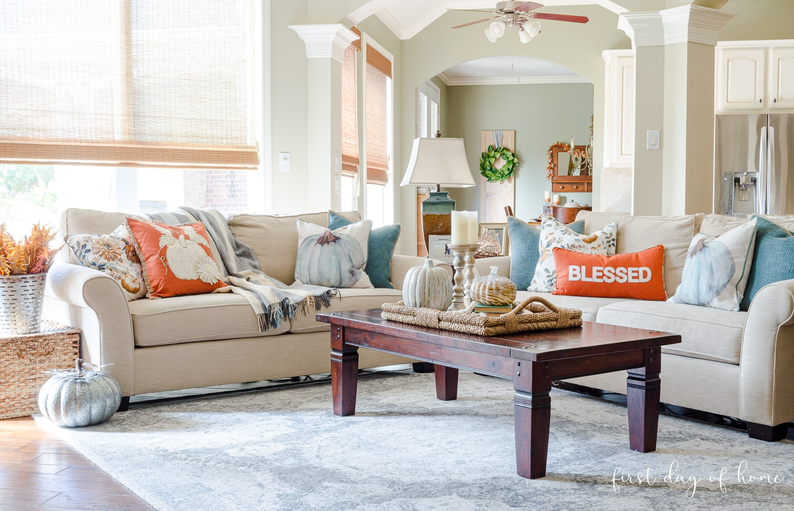 Fall living room decor with aqua and orange