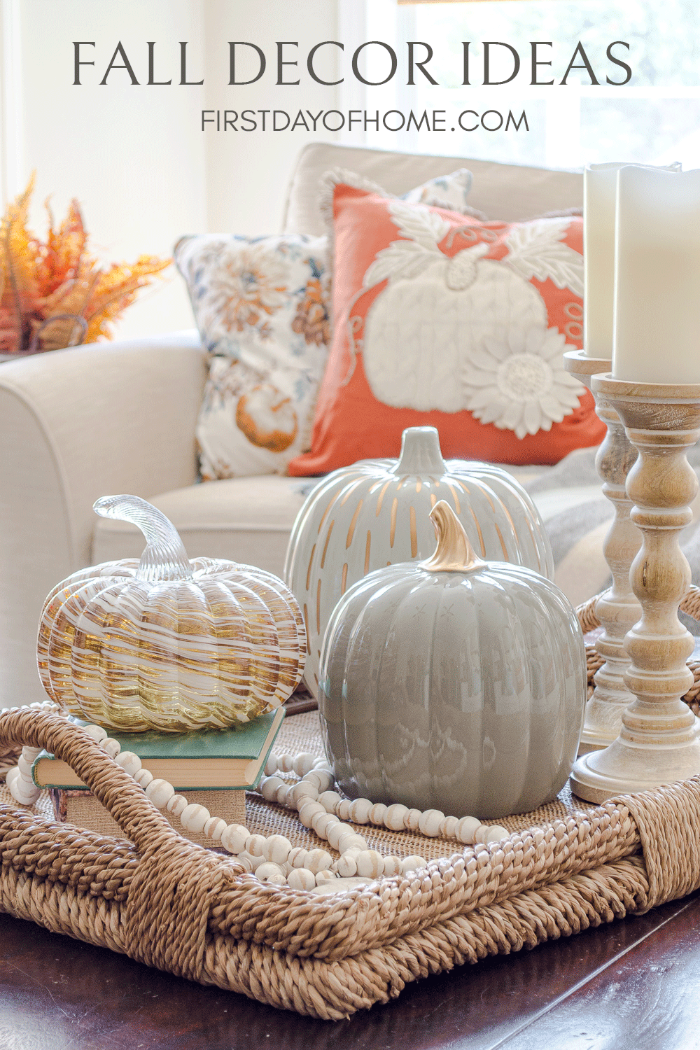 Fall centerpiece on coffee table with pumpkins and candle holders