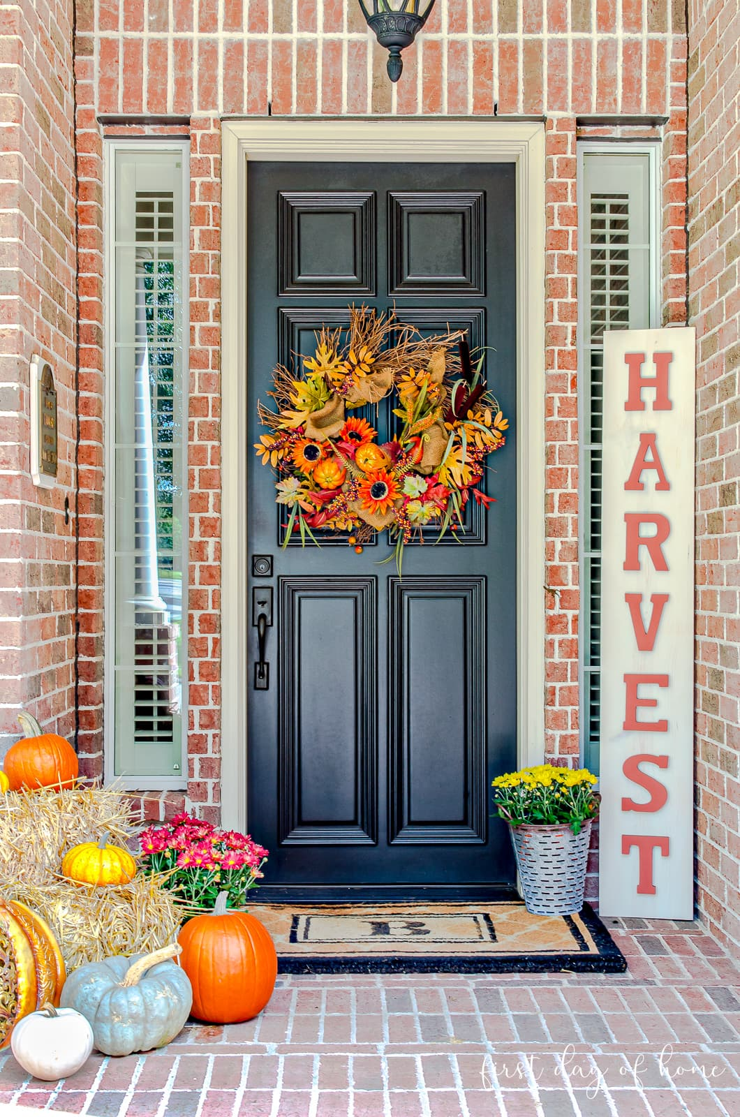 Fall front porch decor with pumpkins, Harvest sign, wreath, hay and other accents