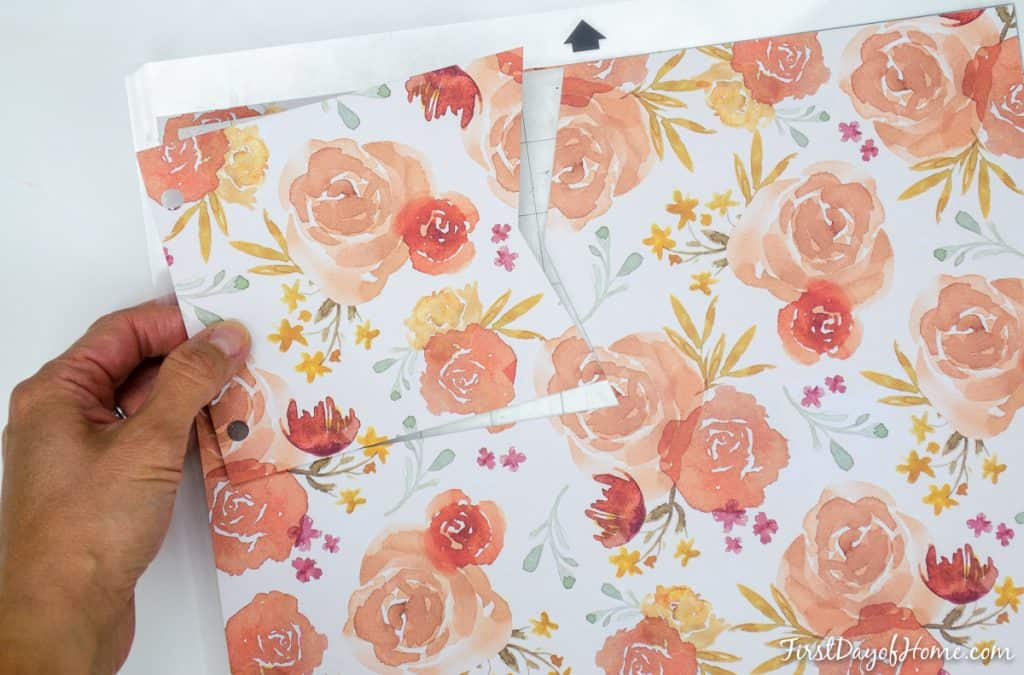 Cutting pennants from scrapbook paper for free harvest pennant banner