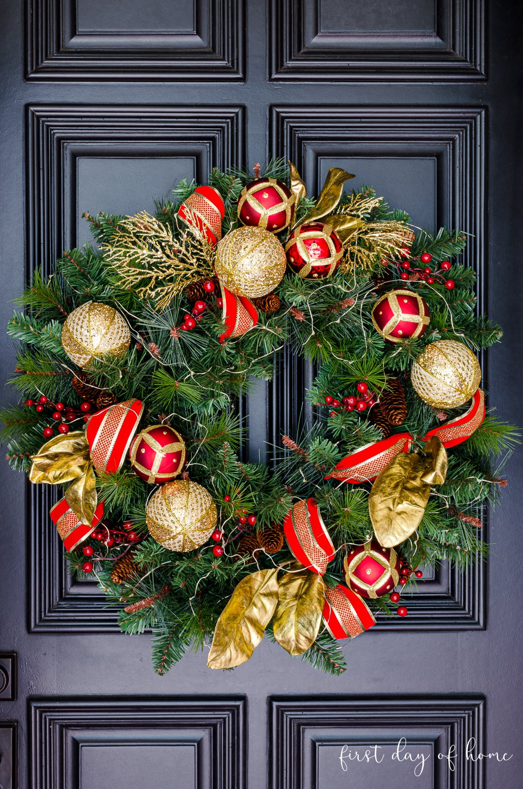 Red and gold Christmas wreath on black front door