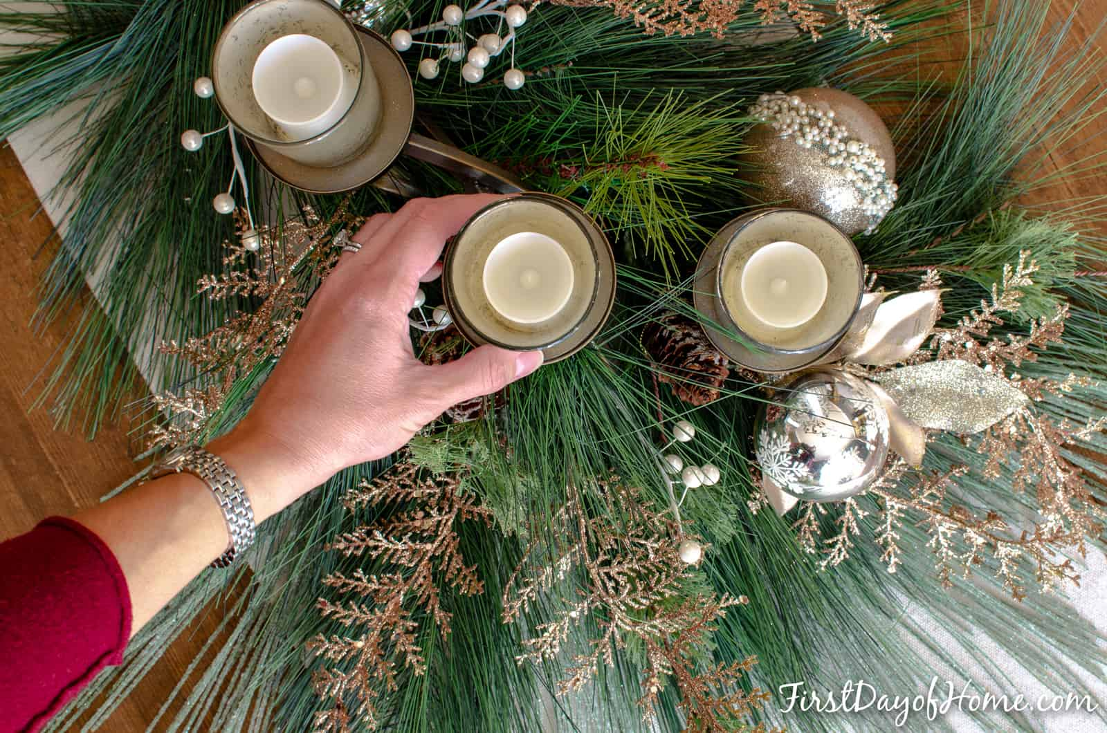 Easy DIY Christmas centerpiece with mercury glass votive candle holders and flameless votive candles. Mix of silver and gold ornaments and accents.