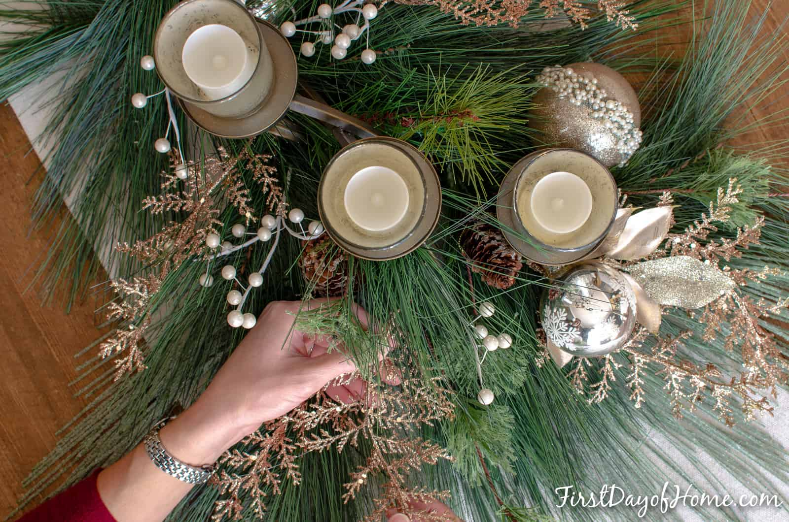 DIY holiday centerpiece with mercury glass votive candle holders, silver and gold ornaments and other faux floral sprays