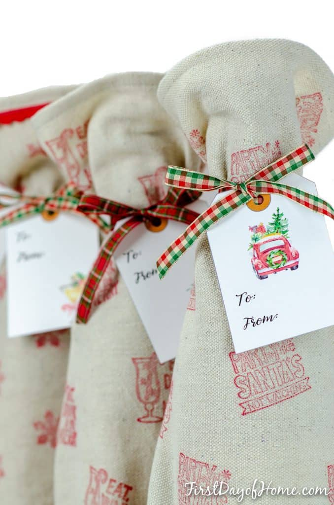 DIY wine gift bags with free printable gift tags using Christmas themed fonts and graphics