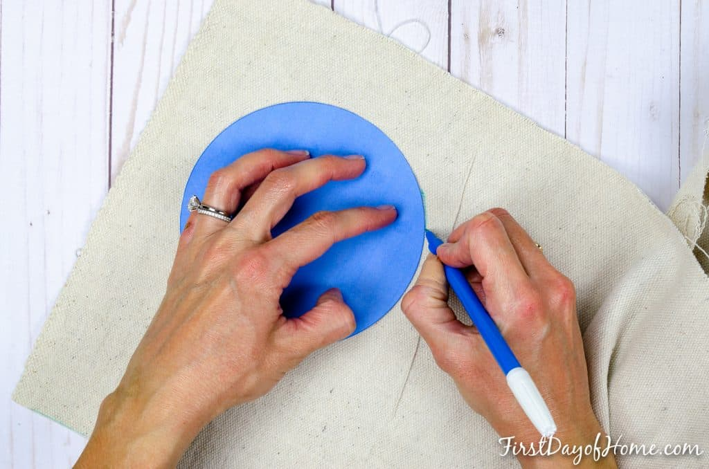 Cutting circular pattern for DIY easy wine gift bag sewing project