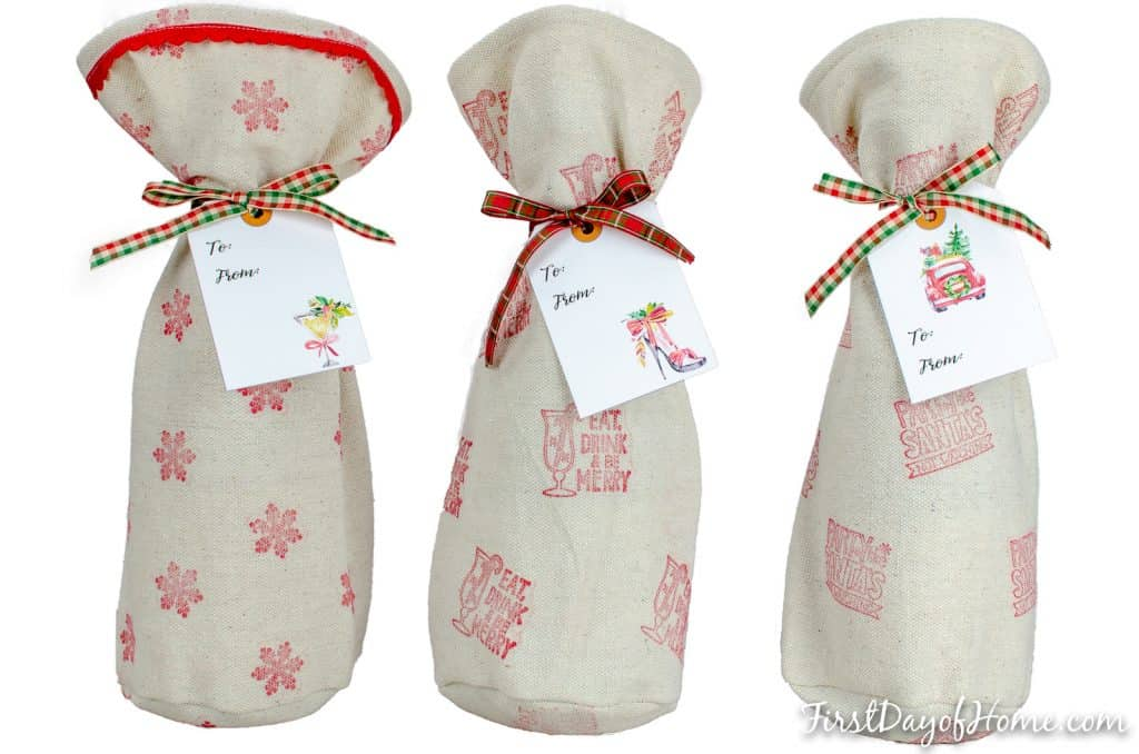 Trio of wine bottles with DIY simple holiday stamped gift bags using drop cloth