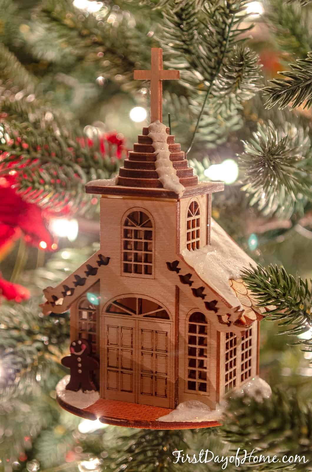 Gingerbread cottage wooden ornament hanging on tree