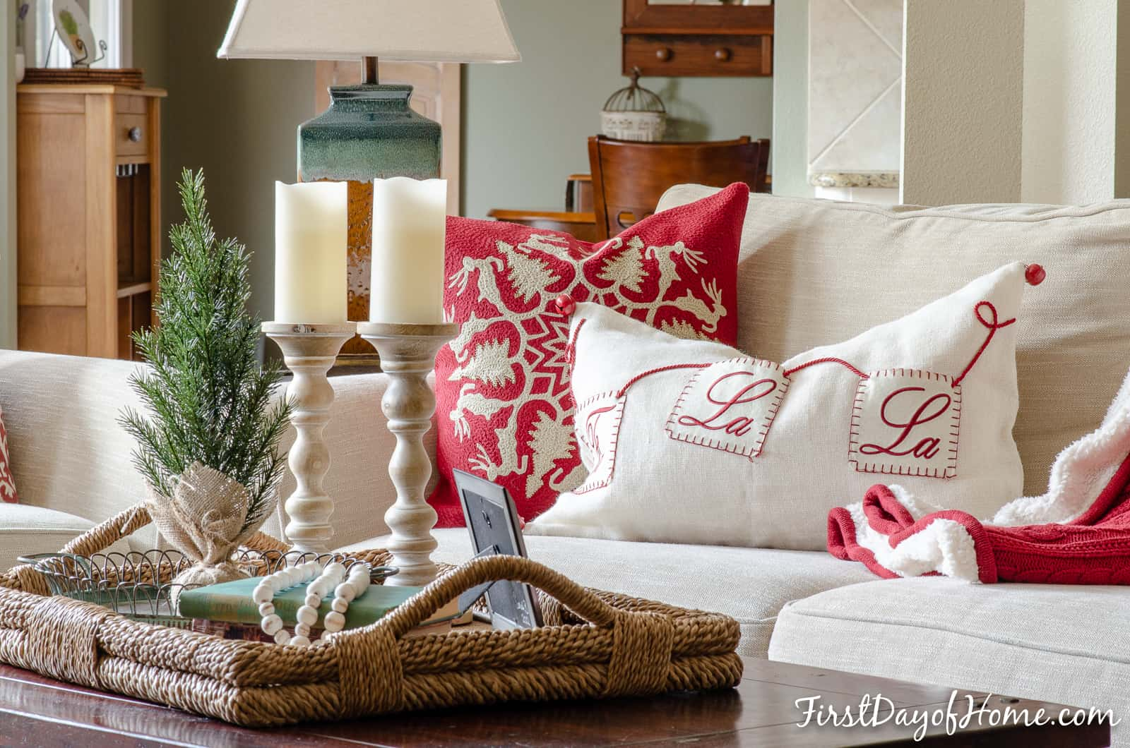 Living room sofa with Christmas throw pillows in red and white