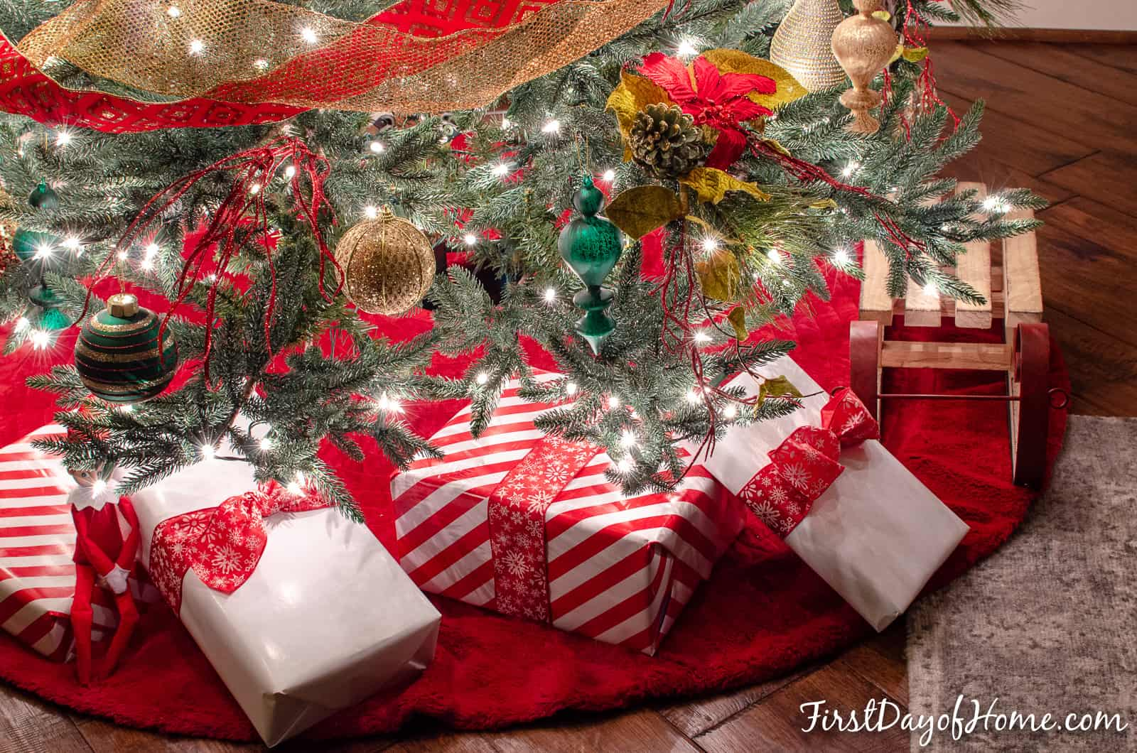 Red and gold decorated Christmas tree with white presents underneath