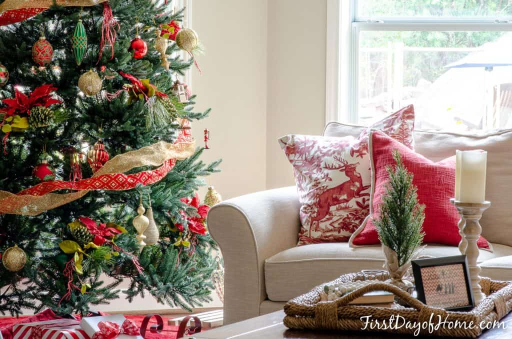 Living room decorated with red and gold Christmas decorations