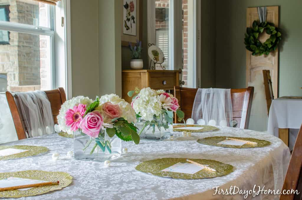 Bridal shower table with floral arrangements, table scatter and free printable advice cards