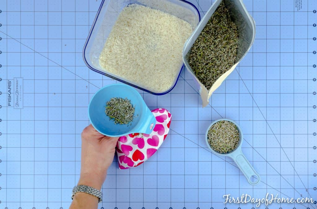 Filling bags with rice and lavender to make lavender microwavable rice heating pad