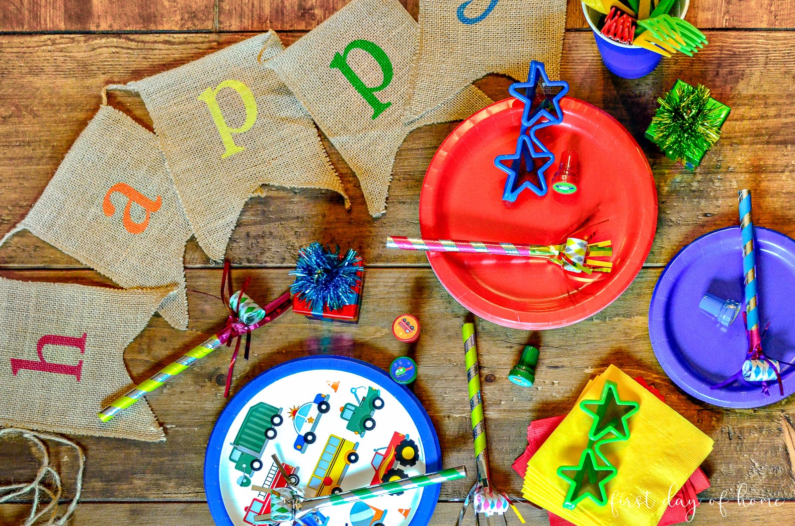 Transportation themed birthday party paper supplies, including transportation plates, napkins and favors;