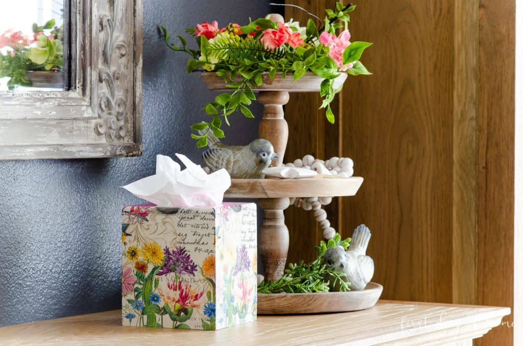 Wooden decoupage kleenex box next to three tiered tray