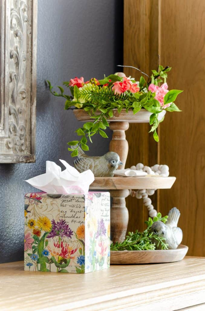 DIY wooden tissue box cover with floral pattern next to three tiered tray