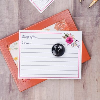 Magnetic photo frame with floral background used as a recipe card holder